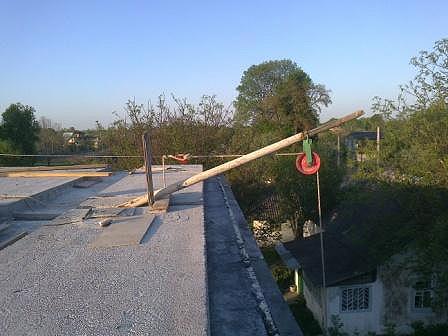 Пример механизма для спуска материалов с крыши